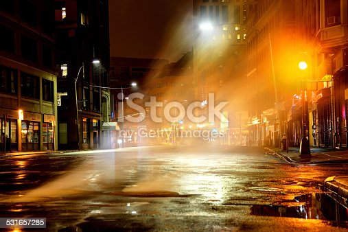 istock Steam rising from manhole cover on city street 531657285