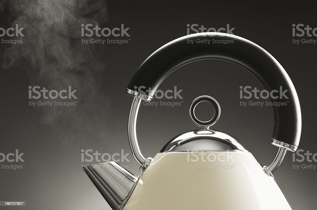 Steam rising from spout of boiling kettle in retro design stock photo