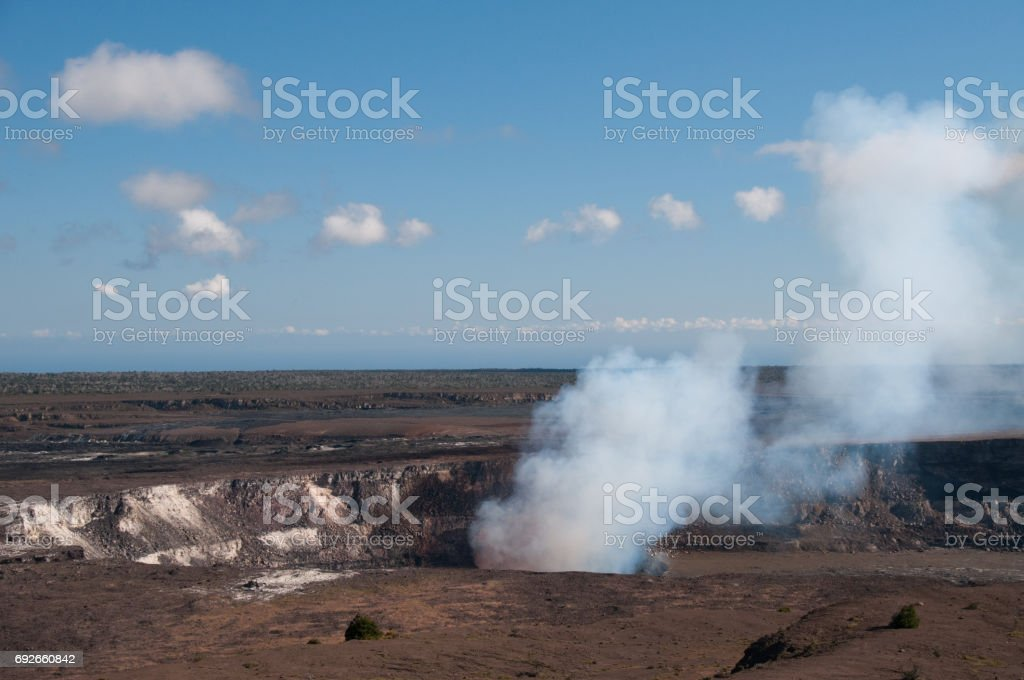 Steam rising from volcanic crater in Hawaii. stock photo
