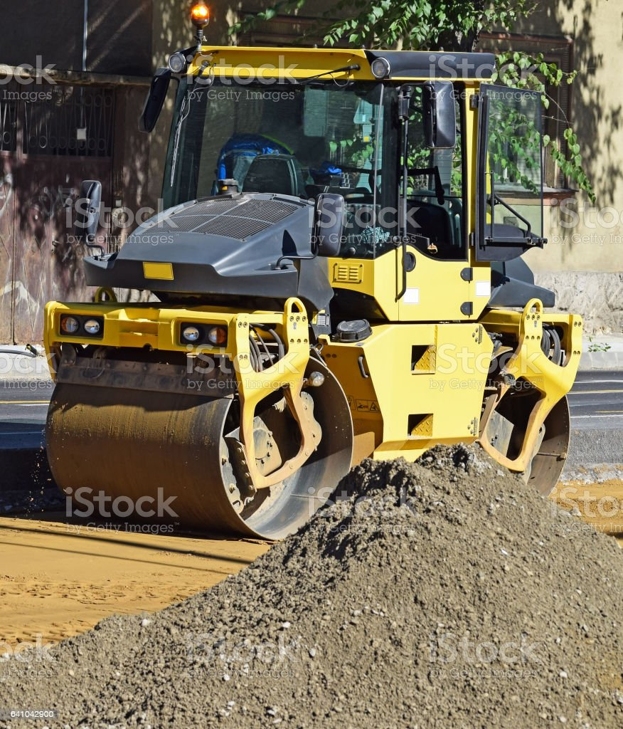 Steam roller at the road construction stock photo