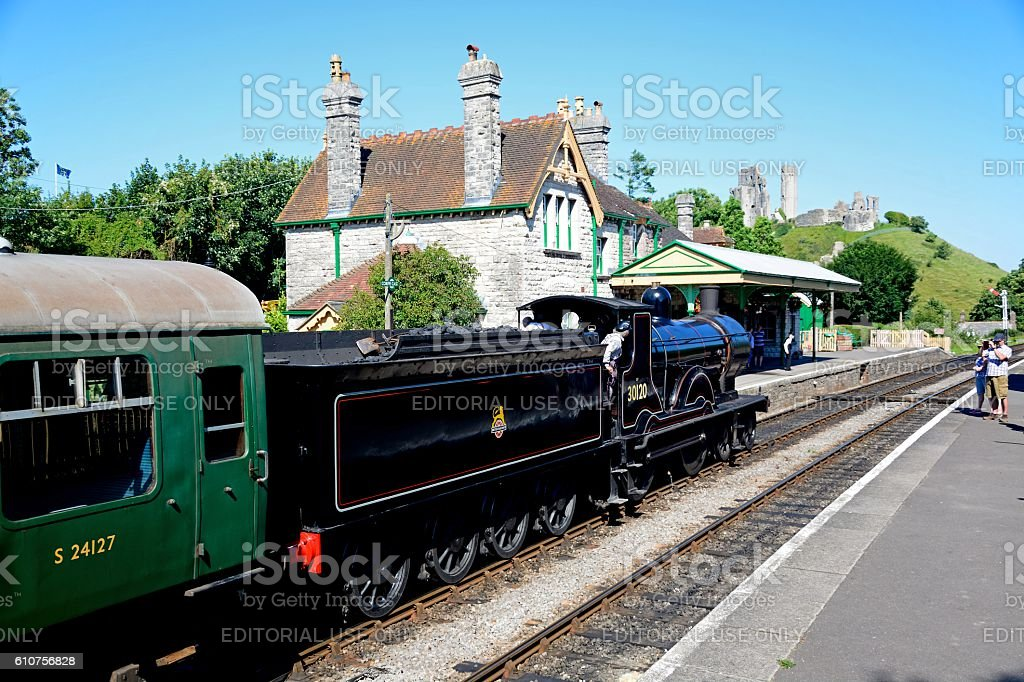 Steam train at Corfe railway station. stock photo