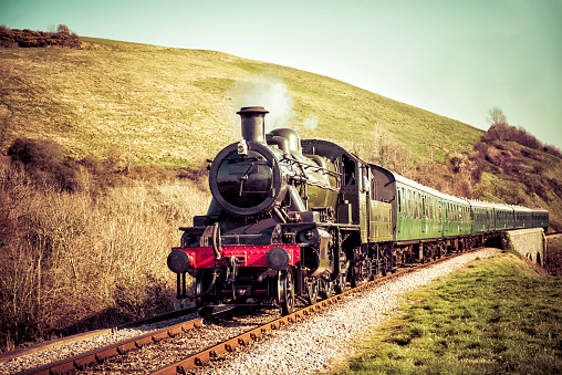 Steam Train Gently Moving Through the English Countryside
