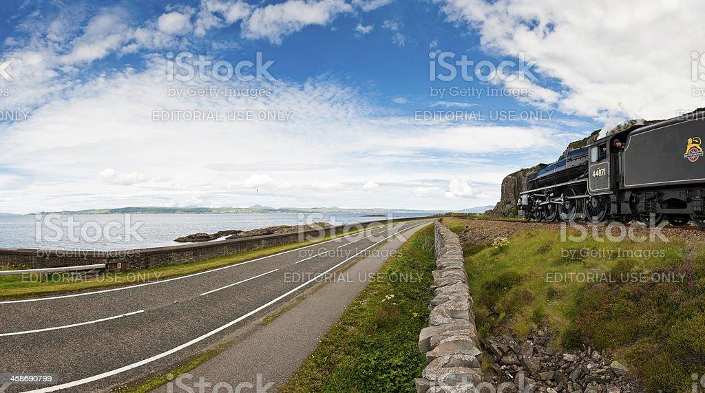 Steam train Highland coast line island road Scotland stock photo