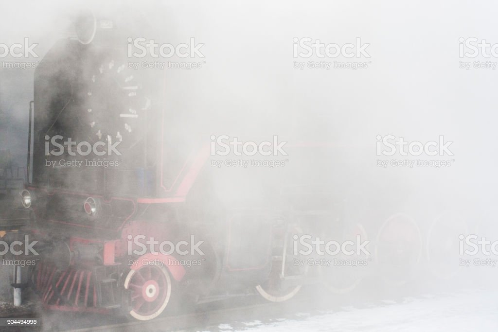 Steam train in clouds of white vapor. stock photo