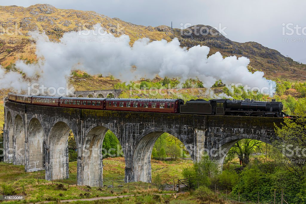 Steam train on Glenfinnan viaduct. Scotland. stock photo