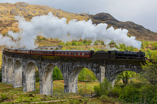 Steam train on Glenfinnan viaduct. Scotland. stock photo