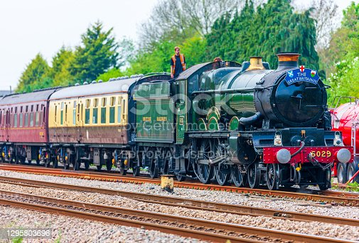 UK steam train on round Britain 9 day tour. Nunney Castle pictured at  Magor in Wales on the 7th day of the tour. Engine is taking on water for the boiler. Engineers are standing on the coal tender supervising this.