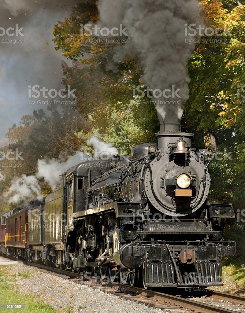 Steam Train through Fall Foliage stock photo