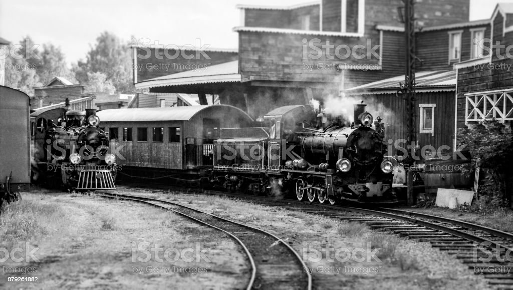 Steam trains at railway station stock photo