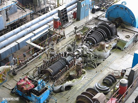 steam turbine in repair process, machinery, pipes, tubes, at an power plant