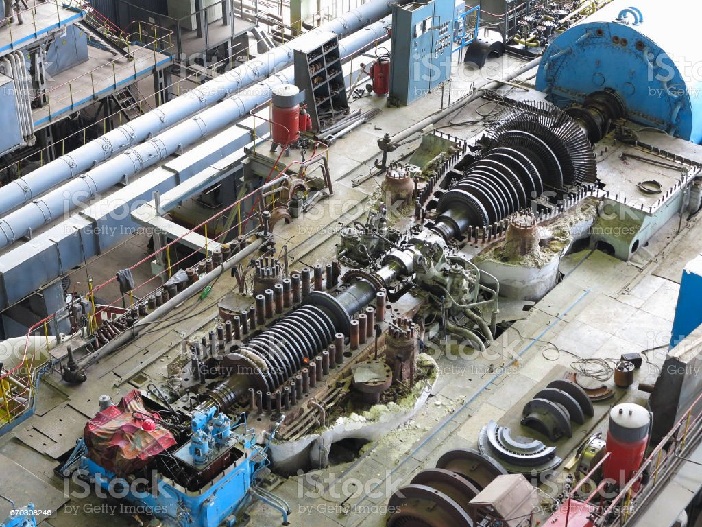 steam turbine in repair process, machinery, pipes, tubes, stock photo