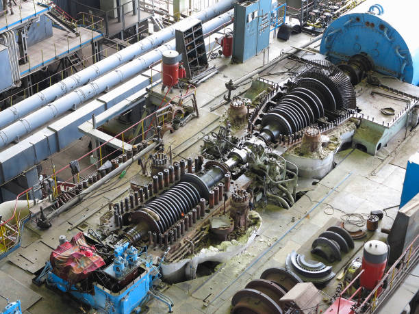 steam turbine in repair process, machinery, pipes, tubes, - Photo
