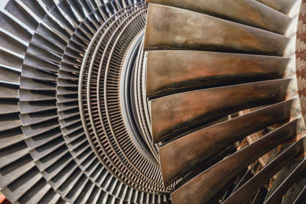 steam turbine metal blade use in power station or jet engine - power in nature stock photos and pictures