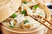 Steamed asian dumplings. Dumplings with fillings