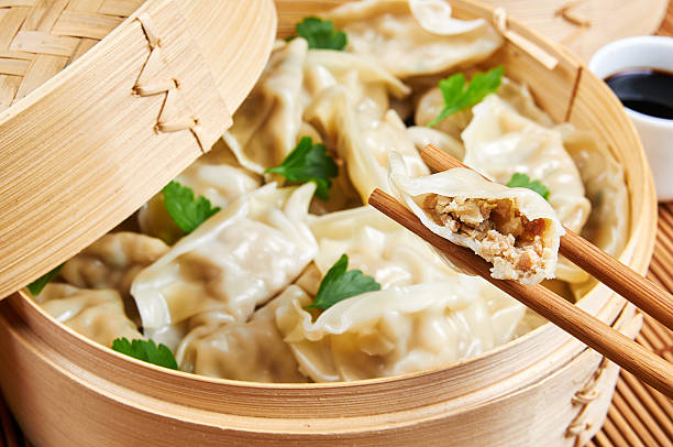 steamed asian dumplings. dumplings filled with vegetables - dumplings stock photos and pictures