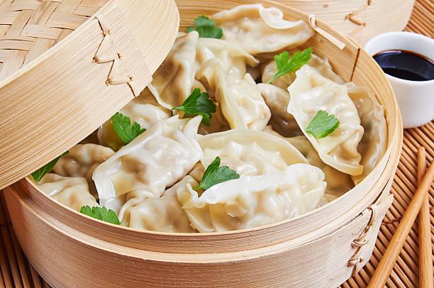 Steamed Asian dumplings. Dumplings with fillings stock photo