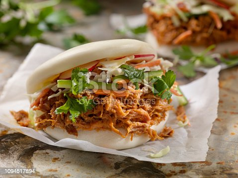 Steamed Bao Buns with Pulled Pork with Carrots, Coleslaw and Cilantro with a Savory Sauce