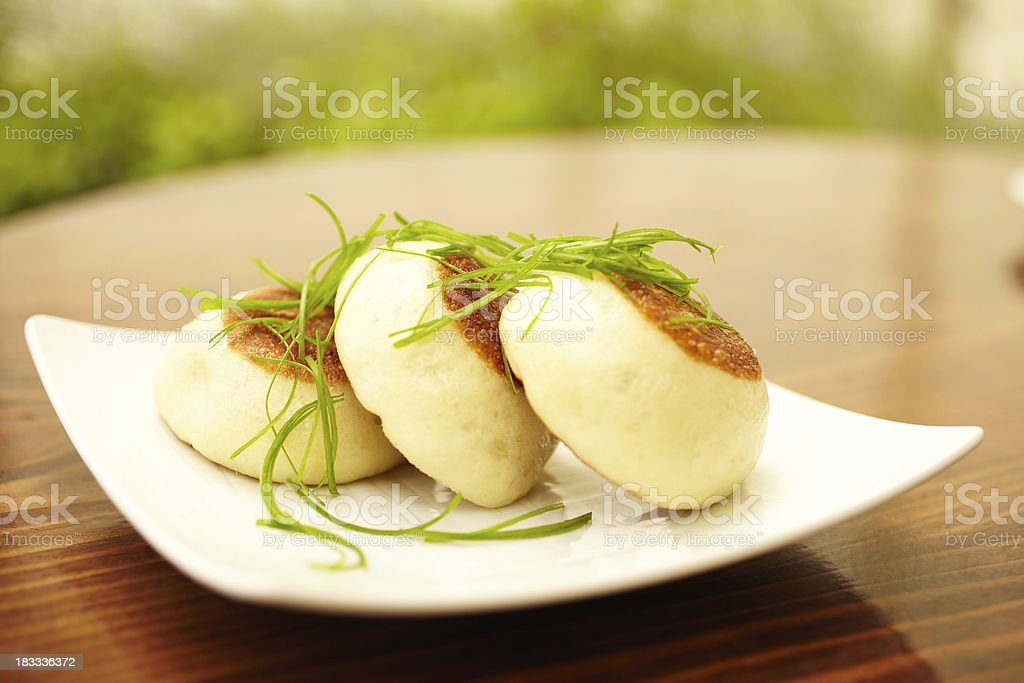 Steamed barbecue pork buns with chives royalty-free stock photo