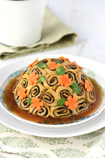 Steamed Bean Curd Roll with Mixed Mushrooms stock photo