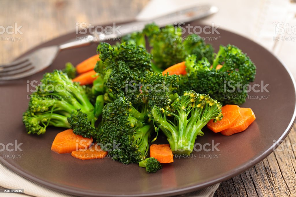 Steamed broccoli on plate. stock photo