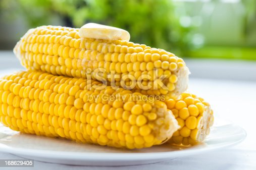 Steamed sweetcorn on the cob with butter