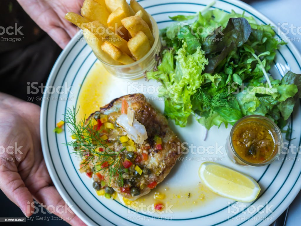 Steamed Fish And Prawn With Lemon Sauce Stock Photo