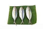 Steamed mackerel fish Put on banana leaf isolated on white background