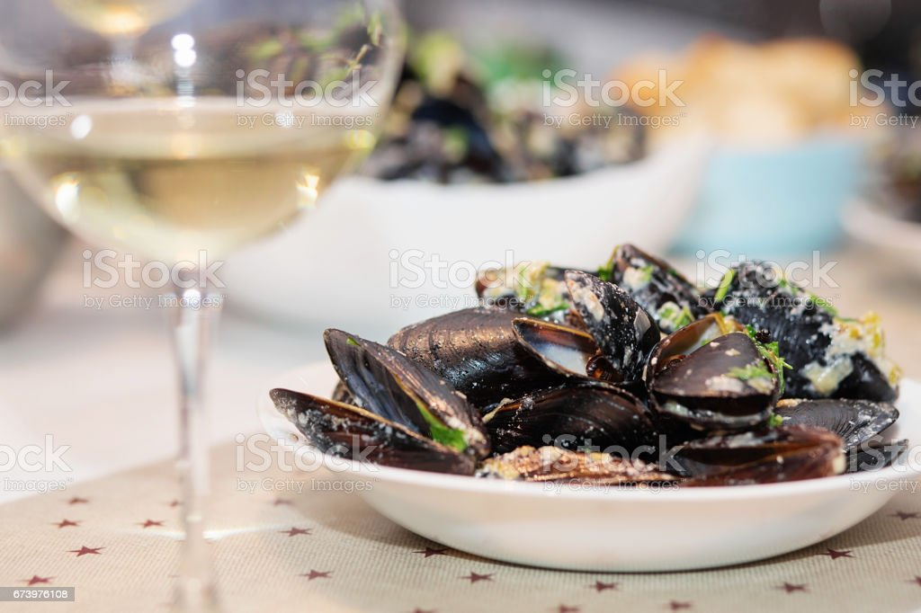 Steamed mussels in cheese sauce. royalty-free stock photo