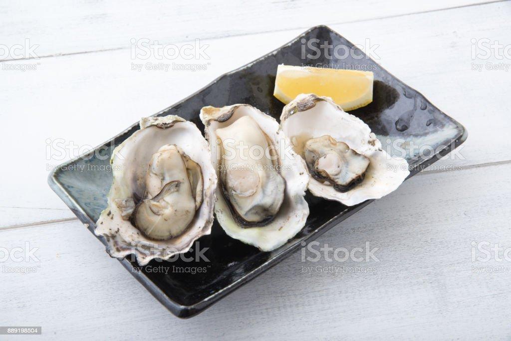 gedämpfte Austern mit Zitrone – Foto