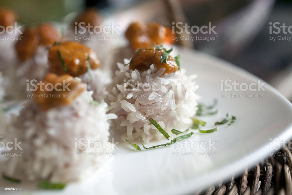 Steamed pork and rice appetizers topped with sea urchin stock photo