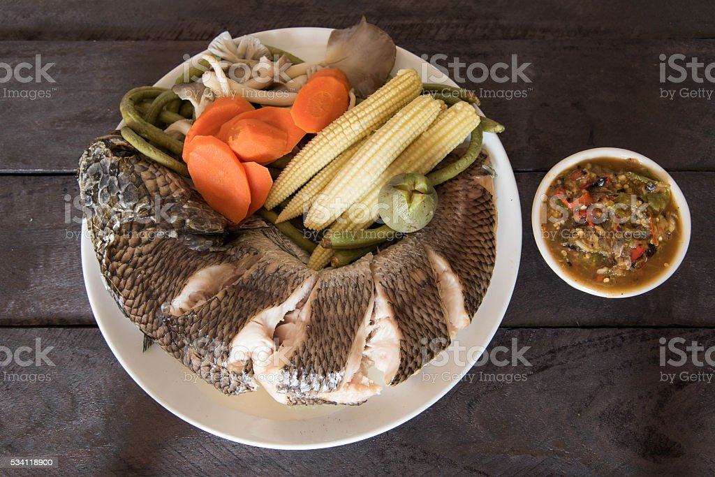 steamed snake head fish and vegetable  served with sauce stock photo