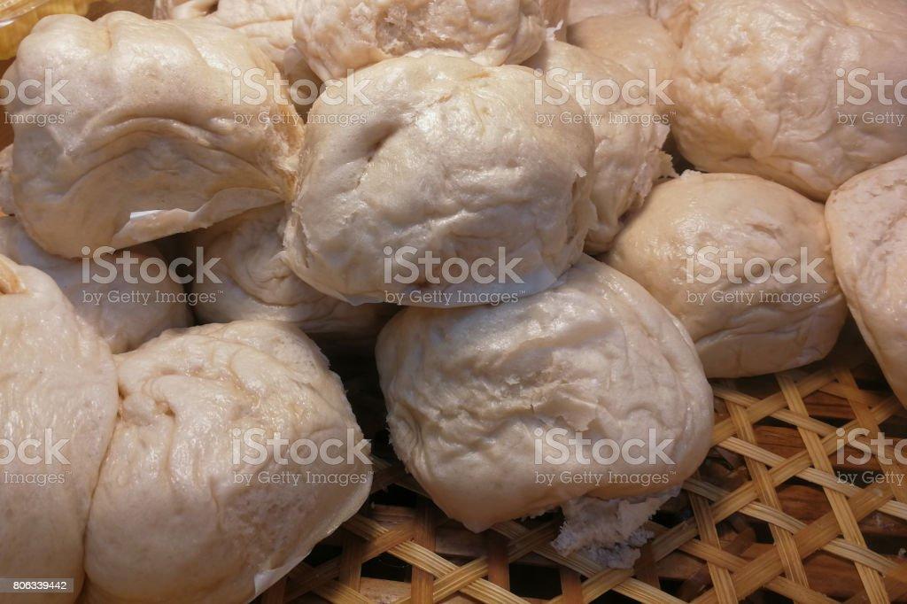 Steamed stuff bun, Chinese food dim sum in bamboo basket stock photo