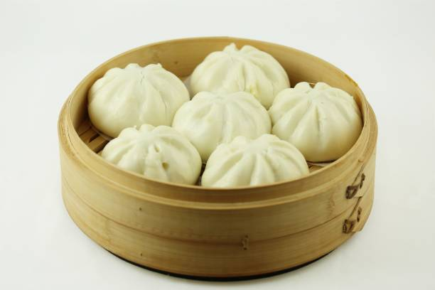 Steamed  stuffed  buns in bamboo steamer stock photo