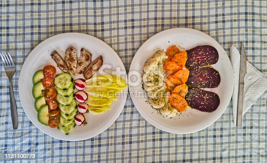 istock Steamed vegetables and fresh salad with grilled tuna belly steaks 1131100773
