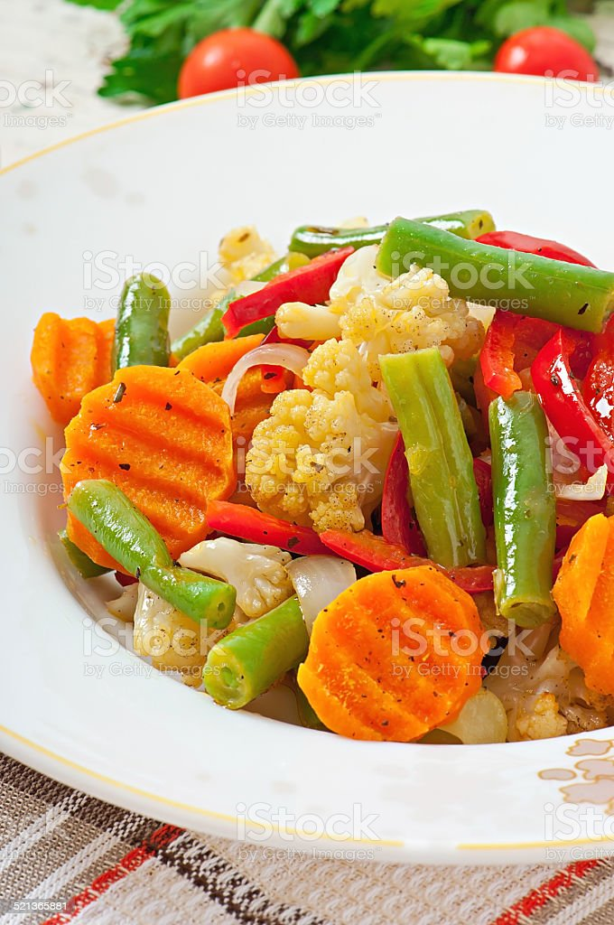 Steamed vegetables - cauliflower, green beans, carrots and onions stock photo