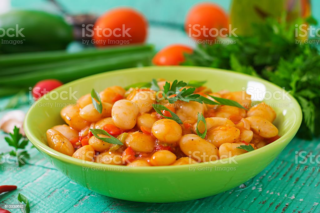 Steamed white beans with vegetables in tomato sauce stock photo