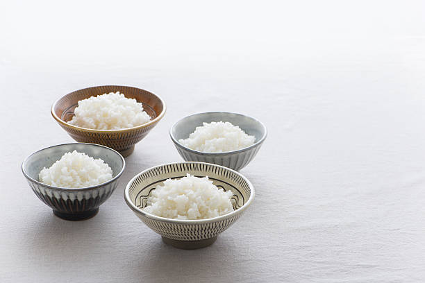 Steamed white rice in rice bowl stock photo