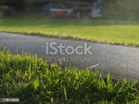 Outdoor close up photography from steaming asphalt after rain.