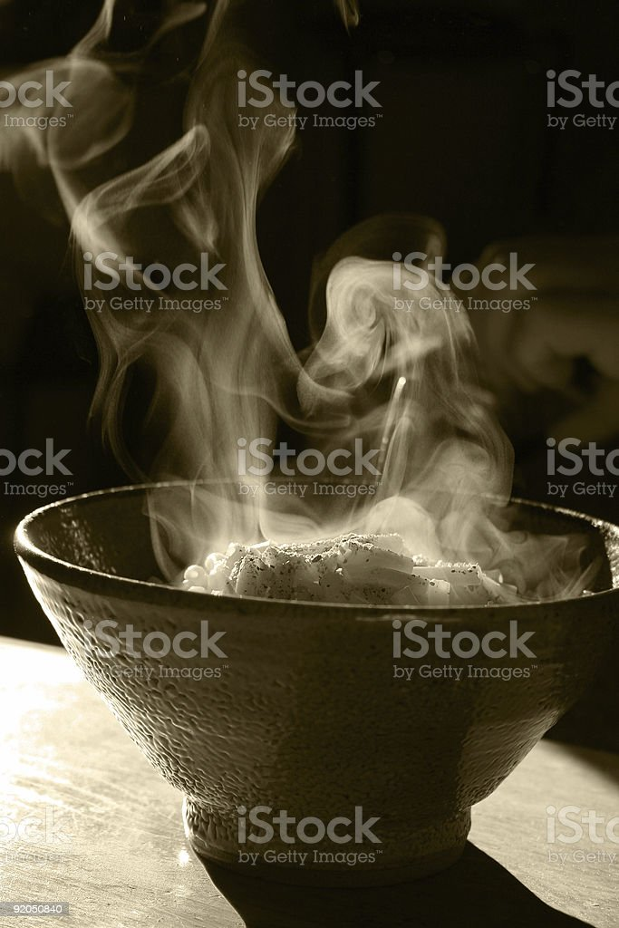 Steaming bowl of noodles royalty-free stock photo