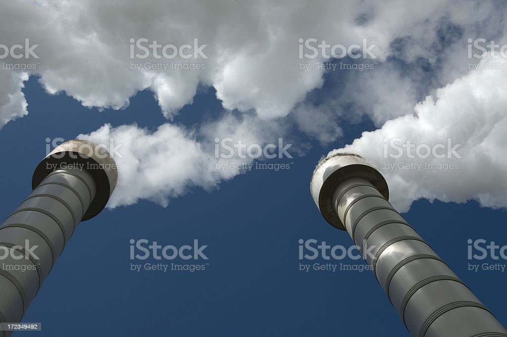 Steaming chimneys stock photo