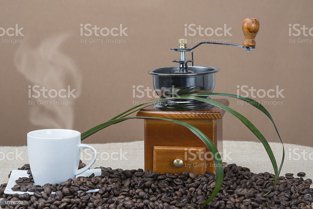 Steaming coffee beside the grinder royalty-free stock photo