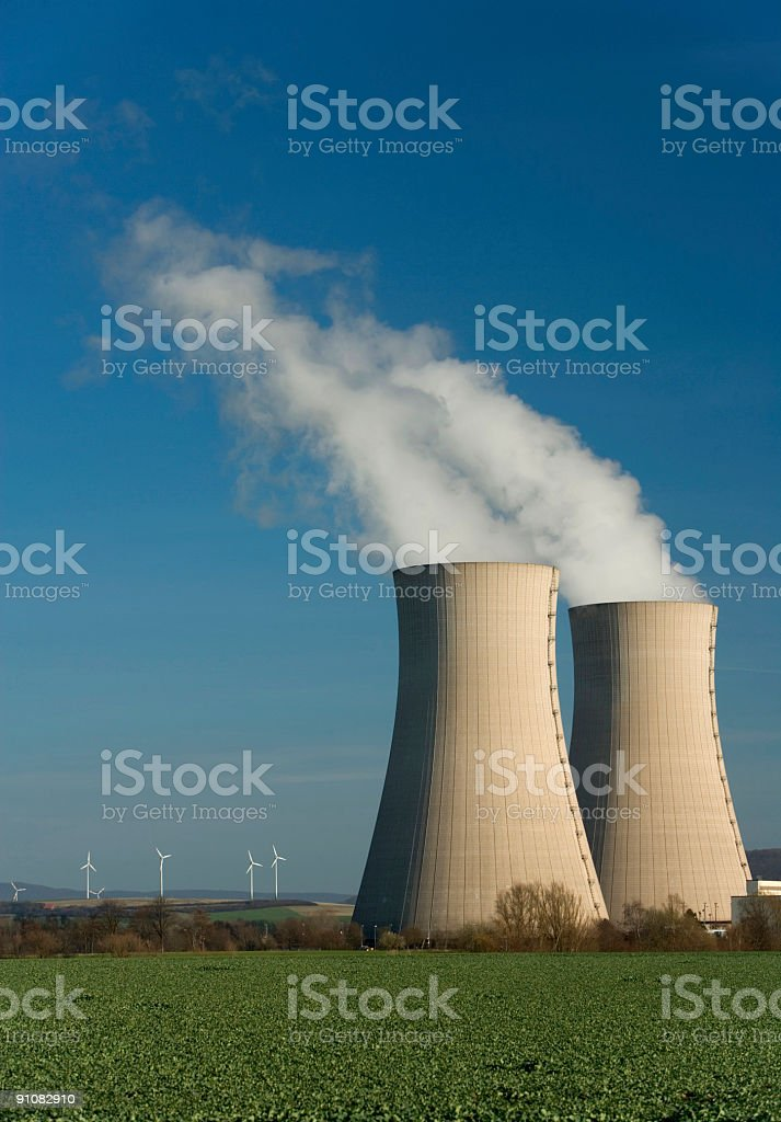 Steaming cooling towers and wind turbines (XL) royalty-free stock photo