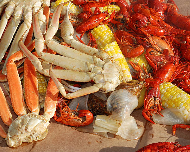 Steaming crab legs and veggies stock photo