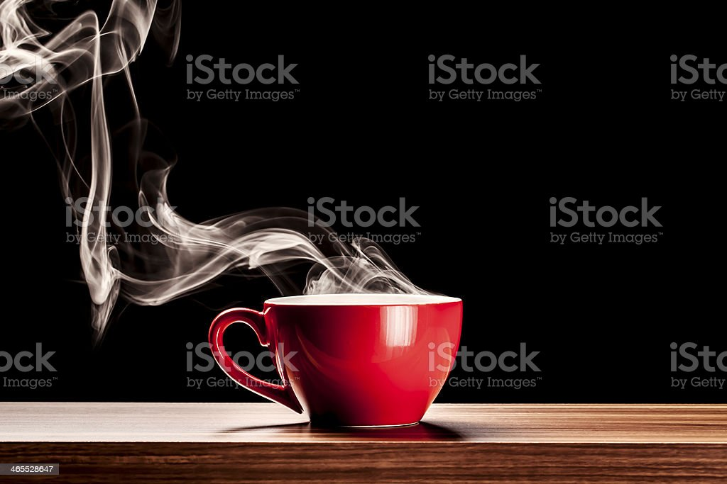 Steaming Cup - Coffee Steam Red Smoke Table Backgrounds stock photo