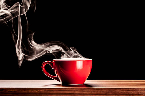 Steaming Cup - Coffee Steam Red Smoke Table Backgrounds Steaming Red Cup black coffee stock pictures, royalty-free photos & images