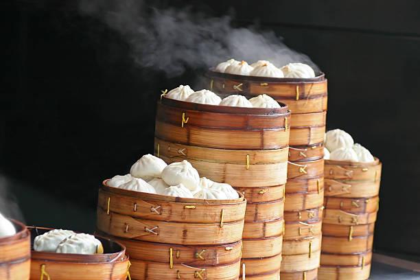 steaming dumplings - dumplings stock photos and pictures