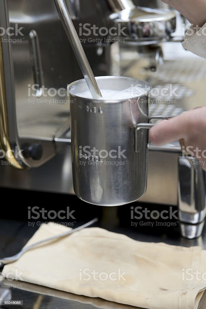 Steaming froth for preparing espresso latte royalty-free stock photo
