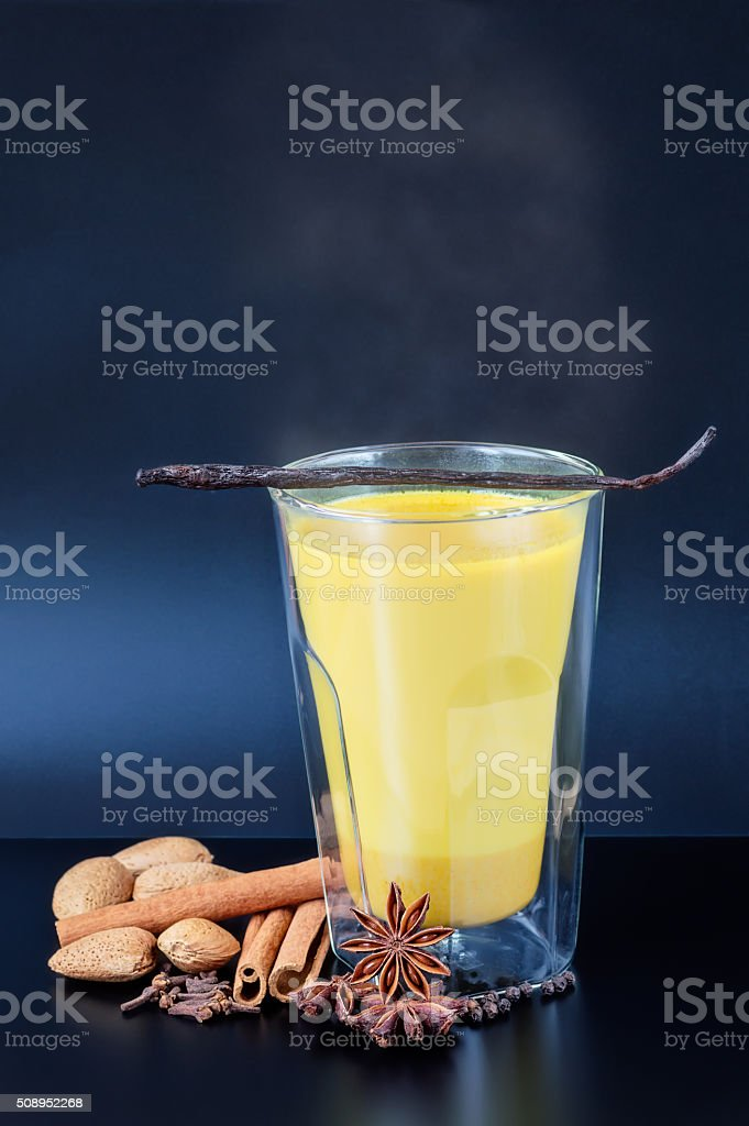 Steaming Golden Milk with Spices stock photo