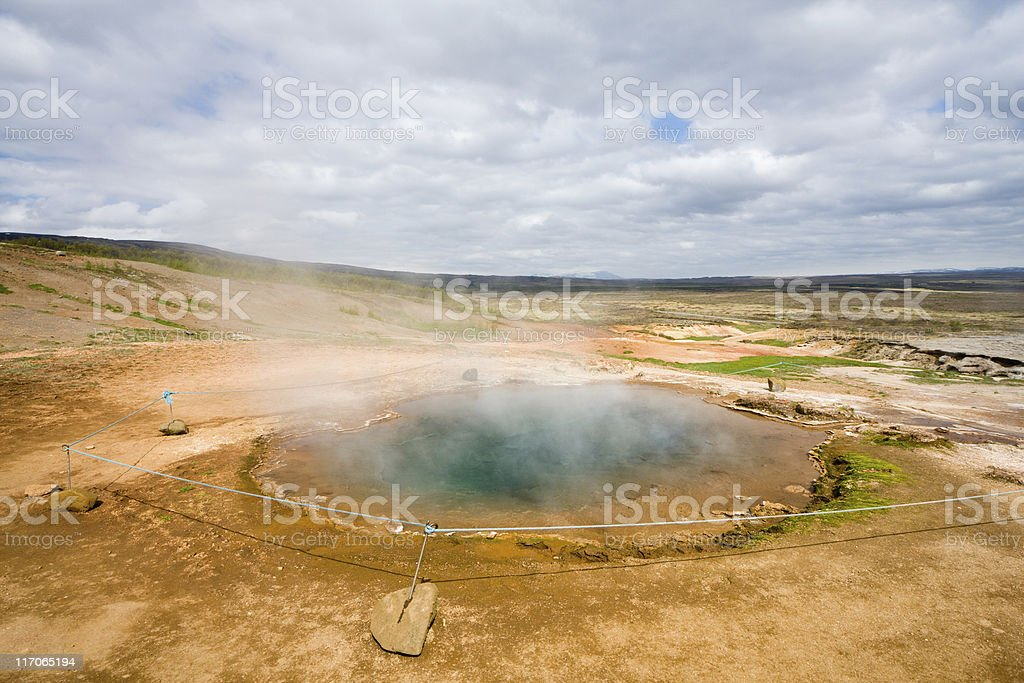 A steaming blue hot spring in the Geysir area in Haukadalur, Iceland.