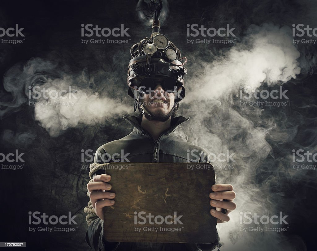 Steaming man with helmet demonstrating mind control concept stock photo